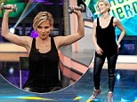 Elsa Pataky wears sleek leather pants as she lifts weights and does push-ups on television