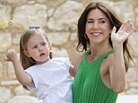 Crown Princess Mary's  three-year-old daughter practiced her royal wave on Wednesday as she sat in her mother's arms at her grandfather Prince Henrik's 80th birthday party