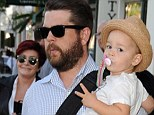 Like grandfather, like granddaughter: Pearl shows her rebellious streak with a two-fingered salute to the photographers on a day out with dad Jack and grandmother Sharon Osbourne
