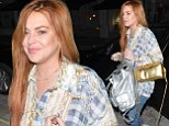Bag lady! Lindsay Lohan loads up on metallic accessories as she heads to the Chiltern Firehouse.... AGAIN