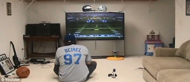 Gamers: This is an image of Sexton playing video games with his Joe Beimel bobblehead doll