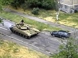 Russia was accused of sending tanks into Ukraine today with Kiev claiming three T-72 tanks entered the country in Snizhne - some 13 miles inside Ukraine. It comes as attention was diverted to chaos in Iraq