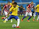 Brazil's Neymar scores from a penalty kick during the 2014 World Cup opening match between Brazil and Croatia at the Corinthians arena in Sao Paulo June 12, 2014. REUTERS/Ivan Alvarado (BRAZIL  - Tags: SOCCER SPORT WORLD CUP)