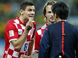 Fuming: Dejan Lovren (left) has blasted Brazil should be given the World Cup following their opening win