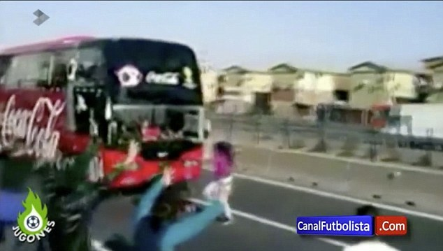 Dicing with death: The fan started dancing in the middle of the road before the bus sharply broke
