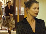 Kate Moss looks effortlessly chic in monochrome dress and black blazer as she dines with friends in Italy