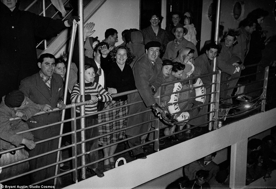 The photographs provide 'an insight into the trials and emotions' refugees experienced on their way from displaced persons camps in places like Yugoslavia and Italy