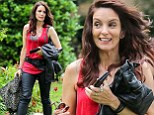Edgy chic: Tina Fey sported a ripped red tank top with a thick leather belt and leather trousers while on set of comedy film The Nest