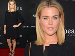 Lady in black: Rachael Taylor steals spotlight from Robert Pattinson and Guy Pearce with chic floaty dress showcasing slim legs at The Rover LA premiere