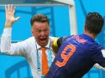 Here's to you, boss: Louis van Gaal celebrates with Robin van Persie (right)