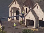 Smash: Construction workers soon moved the crane up to the home's windows