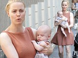 Melissa George looks like a proud mother as she shows off four month old son Raphael while strolling in Italy