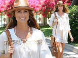 Summer maternity chic! Pregnant Stacy Keibler glows as she shows off her toned legs in pretty white shirt dress
