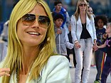 She's a model mom! Heidi Klum shows her fun side as she plays pat-a-cake with her four children at the airport