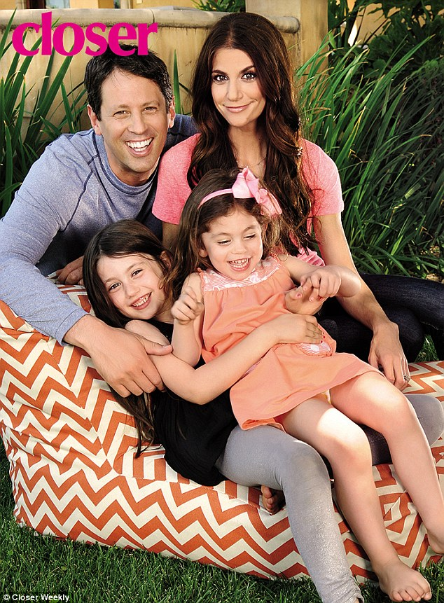 Family woman: The 40-year-old pictured with husband Michael Hess, 44, and their two girls, Josselyn, six, and Hillary, three