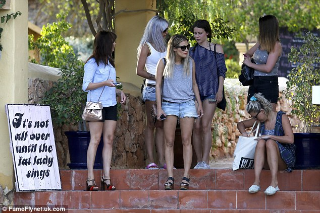 Here come the girls: The 34-year-old teamed a sleeveless grey top with denim shorts as she hung out with her pals