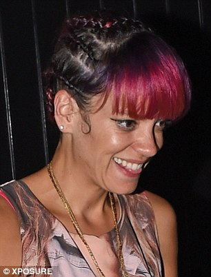 She's pleased: Lily couldn't stop smiling as she exited the London hotel, bar and restaurant