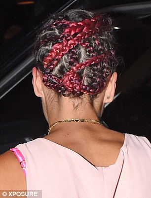 Criss cross: The 29-year-old singer shows of her enw plaited hairstyle outside the popular Marylebone venue