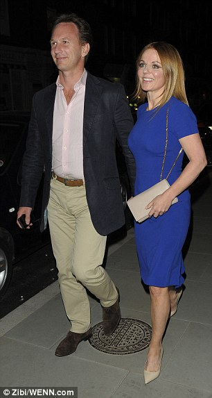 Side by side: Former Spice Girl Geri wore a smart blue dress as she made her way into the popular London venue with F1 boss Horner