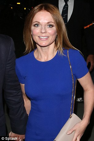 In you go: Geri beams as she makes her way inside