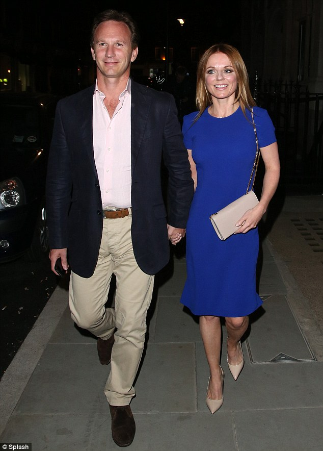 Hand in hand: Geri and Horner are the happy couple as they depart following a meal at the London venue