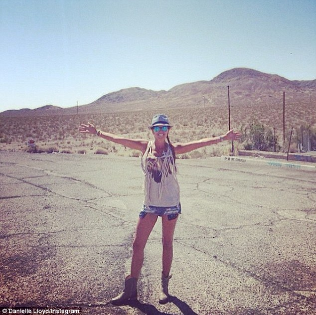 Cowgirl: It's no surprise has been rather taken by the lovely scenery as she stopped to take pictures in the dessert