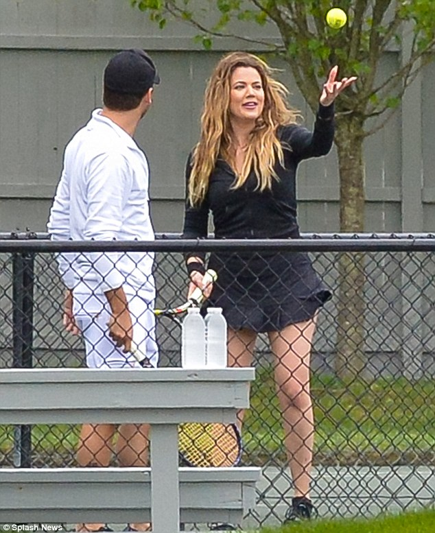She's no Martina Navratilova: Khloe's serving action could use a little work going by her form here