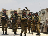 Israeli soldiers deploy near the West Bank city of Hebron, Friday, June 13, 2014. Israeli soldiers searched the West Bank on Friday for three missing teenage...