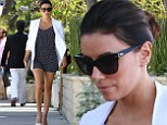 Petite Eva Longoria displays her incredibly toned legs in cute black and white polka-dot jumpsuit as she leaves hair salon to find pesky parking fine