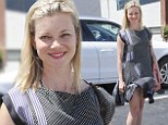 Marilyn moment: Amy Smart's dress got caught in the wind as she stepped out in Los Angeles on Thursday
