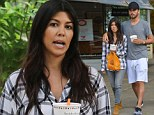 Pregnant Kourtney Kardashian treats herself with frozen yoghurt during Hamptons stroll with Scott Disick