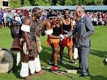 Prince Charles meets an African dance group at a garden party in honour of the British Red Cross Society