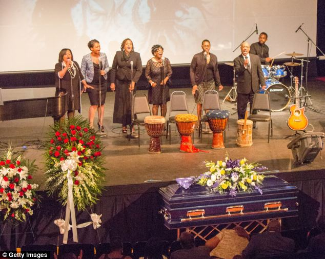 The service featured a performance from a gospel choir (pictured), as well as a song performed by McNair's son