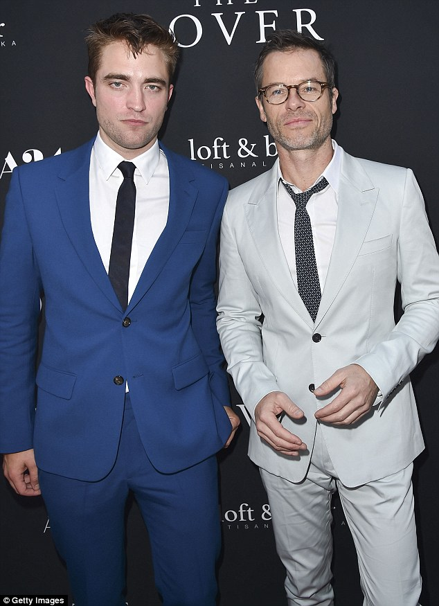 Blue steel: Cracking a smile was tough work for The Rover's Robert Pattinson and Guy Pearce