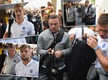Stunned: England players look surprised to see so many fans turn out to see them into their hotel