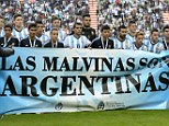 Message: Argentina players held up a banner saying 'The Falklands are Argentine' before their 2-0 friendly win over Slovenia on Saturday
