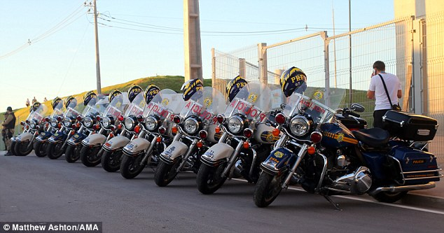 Preparations: Police motorbikes have also lined the streets surrounding the Arena da Amazonia stadium in Manaus