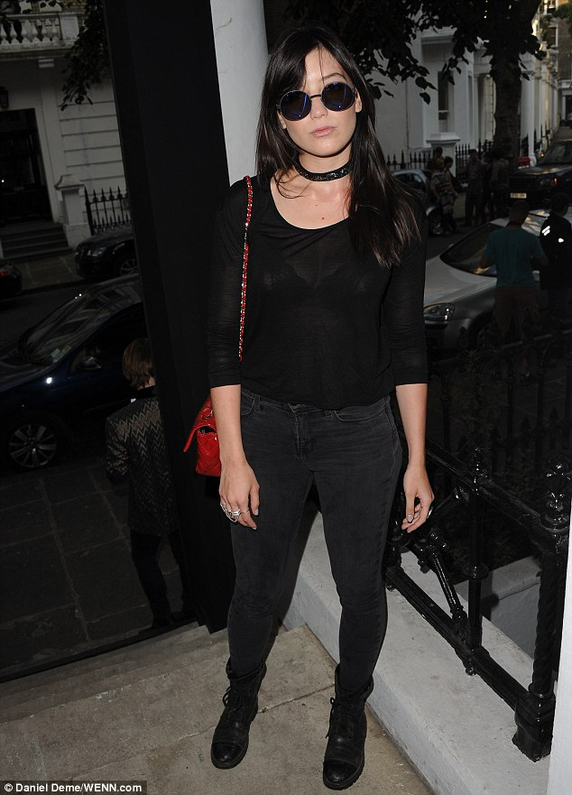 Goth squad: Daisy matched her dark outfit with an even darker look in the Heist private view