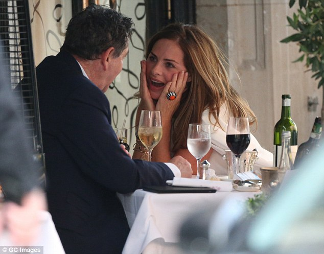 Having fun: In other shots Trinny was seen looking lovingly at Charles as she placed her hands on her cheeks
