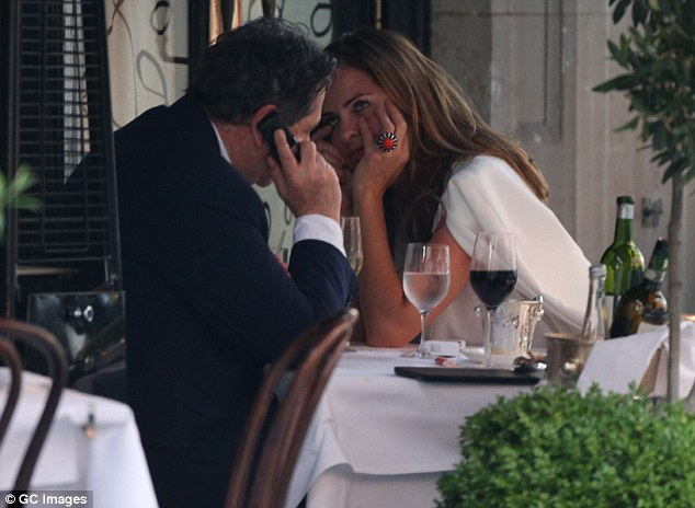 Taking a call: Trinny did appear to be a bit bored while Charles spent some of the conversation on the phone
