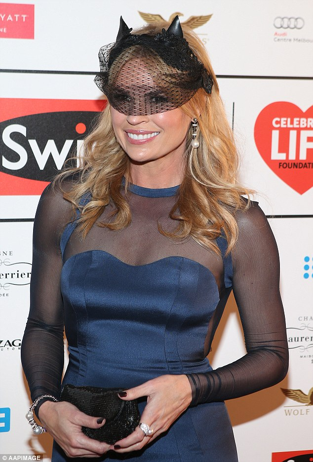 Mysterious girl! Sonia accessorised with a cat themed lace mask for the charity event at Melbourne's Park Hyatt