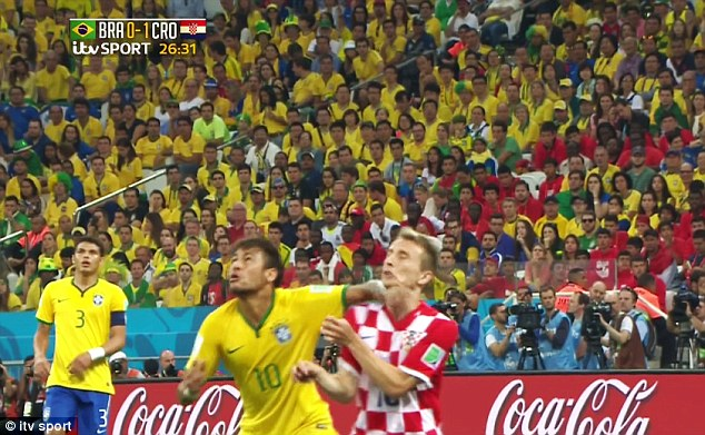 Lucky boy: Two-goal Neymar was fortunate to escape with just a booking for this elbow on Luka Modric