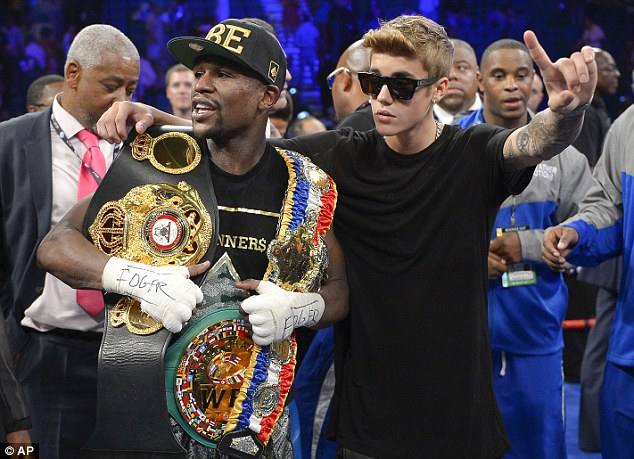 Pals: Mayweather is friends with Justin Bieber and posed after beating Canelo Alvarez in Las Vegas in 2013