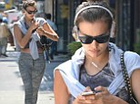 It seems to be working! Irina Shayk flashes toned midriff in crop top and tights after a gym session
