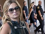Kate Moss flanked by uniformed security as she films new Gucci advert in sexy keyhole cut black dress and PVC boots