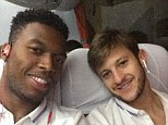 Smile through the pain: Daniel Sturridge and Adam Lallana post a picture of themselves on the bus