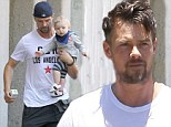 He's quite the adorable handful! Josh Duhamel shows off nine-month-old son Axl while running errands together