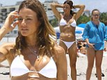 Kelly Bensimon shows off her toned bikini body in a white two-piece during Miami vacation with daughter Sea Louise