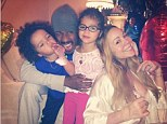 Always the diva! Mariah Carey poses in plunging silk nightgown as she shares sweet snap with husband Nick Cannon and their twins for Father's Day