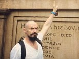 'Blackbeard everywhere I look!': Bald Hugh Jackman refers to his latest role in Peter Pan as he points to a monument in Disney World
